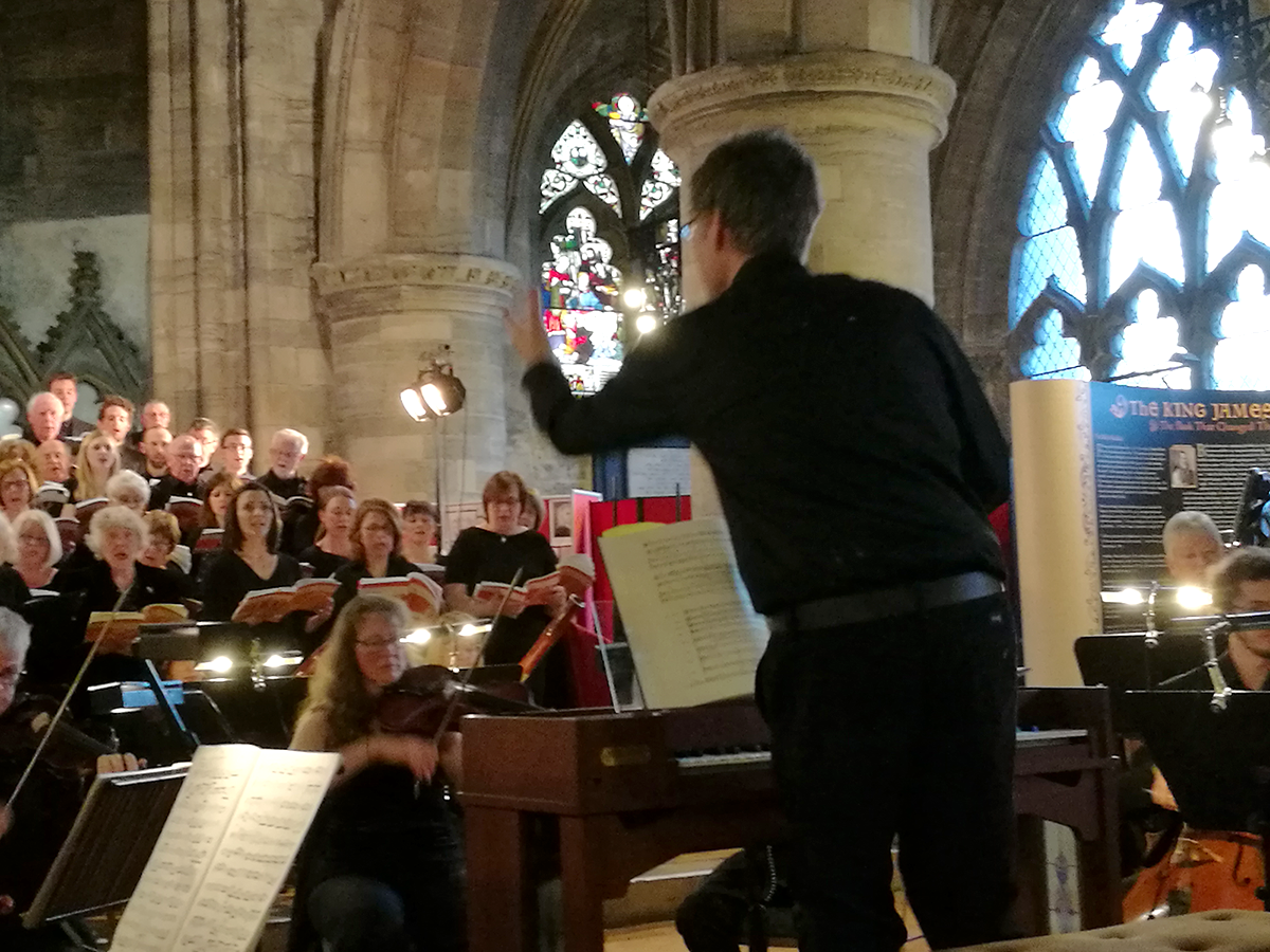 Alistair Warwick conducting Stirling University Choir with professional orchestra in Messiah